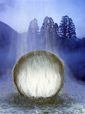 Water Cascading Over Crystal Sphere with Silhouette of Trees in Background Photographic Print by Green Light Collection
