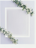White Plaster Frame with Greenery And White Flowers in Each Corner Photographic Print by Green Light Collection