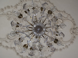 Low Angle View of a Chandelier in a Palace Photographic Print by Green Light Collection