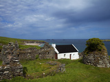 Cottage And Deserted Cottages on Great Blasket Island Photographic Print by Green Light Collection