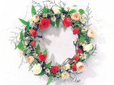 Wreath of Pink, Red And White Roses And Green Vines on White Wall Photographic Print by Green Light Collection