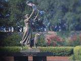 Statue in a Garden, the Waving Girl, Savannah, Georgia, USA Photographic Print by Green Light Collection