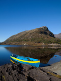 Brightly Coloured Rowing Boat on the Long Range Photographic Print by Green Light Collection
