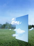 White Clouds Passing Through a Pale Blue Horizontal of Sky with Green Grass Photographic Print by Green Light Collection