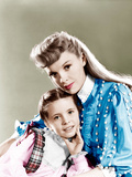 MEET ME IN ST. LOUIS, from left: Margaret O'Brien, Judy Garland, 1944 Posters