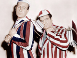 HERE COME THE CO-EDS, from left: Bud Abbott, Lou Costello, 1945 Affiches