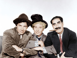 A NIGHT AT THE OPERA, from left: Chico Marx, Harpo Marx, Groucho Marx [The Marx Brothers], 1935 Photo