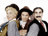 From left: Harpo Marx, Chico Marx, Groucho Marx, (the Marx Brothers), MGM portrait Photo