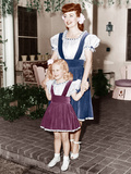 Joan Crawford and her adopted daughter, Christina Crawford wearing matching outfits, ca. 1940s Photo