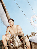 Errol Flynn relaxing on his yacht, ca. 1937 Posters