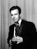 1961: MAXIMILIAN SCHELL [Best Actor, JUDGMENT AT NUREMBERG] holds his Oscar, 1962 Photo
