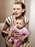 Judy Garland holds baby daughter, Liza Minnelli, 1946 Print