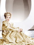 ARTISTS AND MODELS ABROAD, Joan Bennett wearing a gold lame negligee designed by Edith Head, 1938 Photo