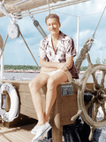 Errol Flynn relaxing on his yacht, ca. early 1940s Posters