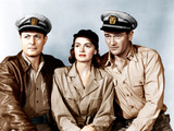 THEY WERE EXPENDABLE, from left: Robert Montgomery, Donna Reed, John Wayne, 1945 Photo