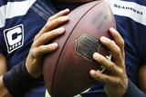 Seahawks Football: Russell Wilson Fotografisk trykk av Elaine Thompson