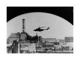 Helicopter Spraying Decontaminants Over Buildings Giclee Print by Ria Novosti