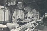 Interior View of a Laundry with a Line of Women Ironing Photographic Print by  English Photographer