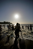 People Running Into the Sea Photographic Print by Carlos Dominguez