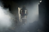 Fire Fighter In a Burnt House Photographic Print by Michael Donne