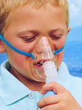 Boy Using An Inhaler for Asthma Photographic Print by Hannah Gal
