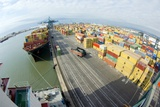 Container Ship And Port Photographic Print by Dr. Juerg Alean