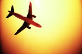 Plane Silhouetted Against the Sun Photographic Print by Kevin Curtis