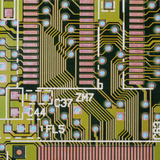 Macrophotograph of a Circuit Board Photographic Print by Dr. Jeremy Burgess