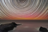 Aurora Australis And Star Trails Photographic Print by Alex Cherney