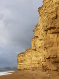 Eroded Cliffs At Burton Bradstock Photographic Print by Adrian Bicker