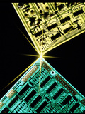 Two Circuit Boards Meeting At a Spot of Light. Photographic Print by Tony Craddock