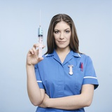 Nurse with Syringe Premium Photographic Print by Kevin Curtis
