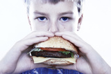 Boy Eating a Burger Photographic Print by Kevin Curtis