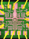 Coloured SEM of a 7401 TTL Integrated Circuit Photographic Print by Dr. Jeremy Burgess