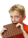 Boy Eating Chocolate Photographic Print by Ian Boddy