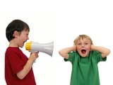 Boy Shouting Into a Megaphone Photographic Print by Kevin Curtis