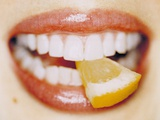 Slice of Lemon Between Teeth Premium Photographic Print by  Cristina