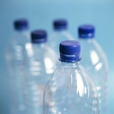 Plastic Water Bottles Photographic Print by  Cristina