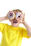 Boy Playing with Doughnuts Print by Ian Boddy