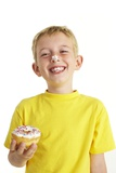 Boy Eating a Doughnut Posters by Ian Boddy