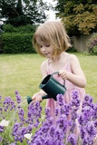 Young Girl Watering Flowers Prints by Ian Boddy