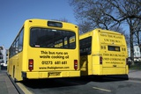Waste Cooking Oil Buses Photographic Print by Martin Bond