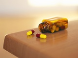 Bottle of Pills Photographic Print by Kevin Curtis