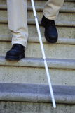 Blind Man Descending Stairs Photographic Print by  Cristina