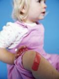 Injured Baby Girl Photo by Ian Boddy