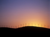 Wind Turbines At Sunset Photographic Print by Martin Bond