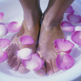 Petals In a Foot Bath Premium Photographic Print by  Cristina