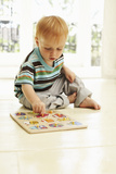 Boy Playing Photographic Print by Ian Boddy