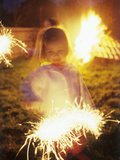 Girl Holding Sparkler Photographic Print by Ian Boddy