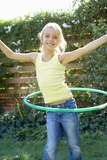 Girl Playing with a Hula Hoop Photographic Print by Ian Boddy